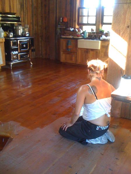 Amber spreading Velvet Oil on the barn loft floor
