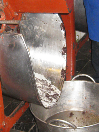 grinding cacao in Mercado de Benito Juarez, Oaxaca